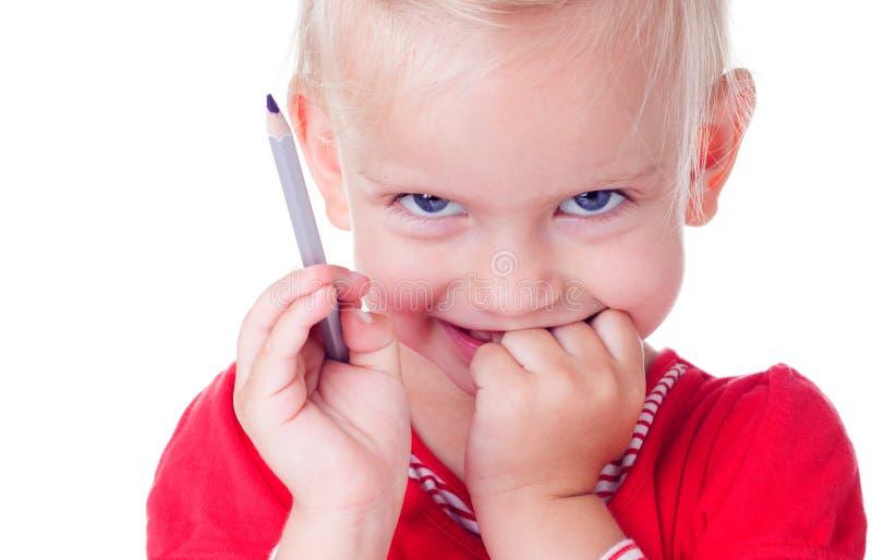 Śliczny mała dziewczynka rysunek z ołówkami obrazy stock
