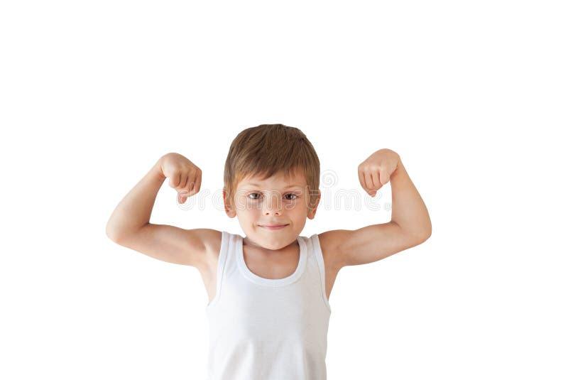 Śliczny zdrowy dzieciak pokazuje jego mięśnie na białym odosobnionym tle zdjęcia stock