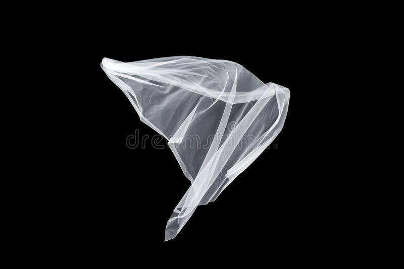 Ślubna biała Bridal przesłona odizolowywająca na czarnym tle przesłona trzepocze w wiatrze fotografia royalty free