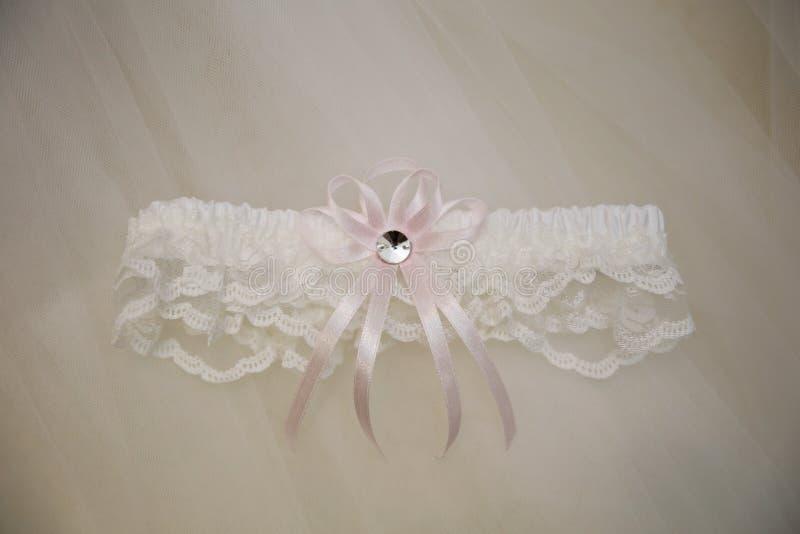 Ślubny tło z bridal podwiązką zdjęcie stock