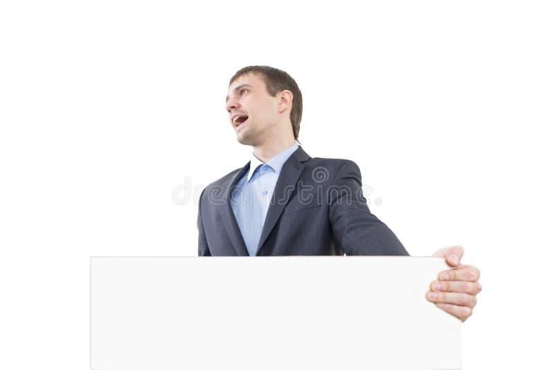 Śmiechu biznesowy mężczyzna pokazuje pustego signboard obraz stock