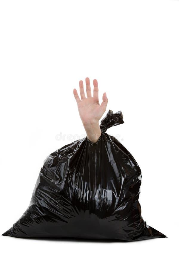 śmieciarska torby ręka obraz royalty free