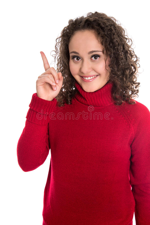 Śmieszna ładna odosobniona młoda nastolatek kobieta przedstawia dowcip w czerwieni fotografia stock