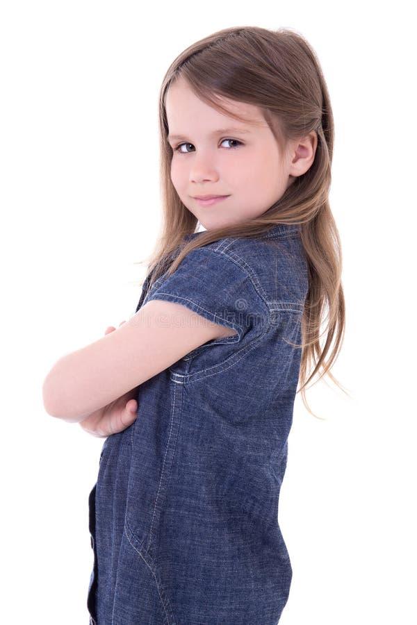 Śmieszna śliczna mała dziewczynka w drelich sukni odizolowywającej na bielu obraz royalty free