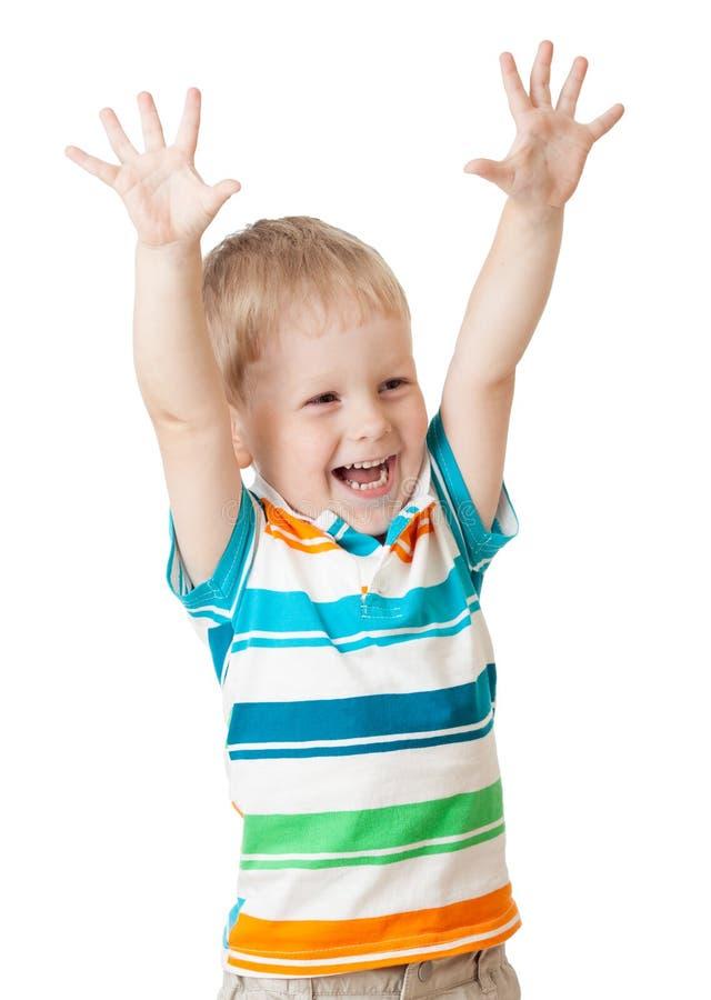 Śmieszna dzieciak chłopiec krzyczy z jego rękami w górę odosobnionego na bielu zdjęcia stock