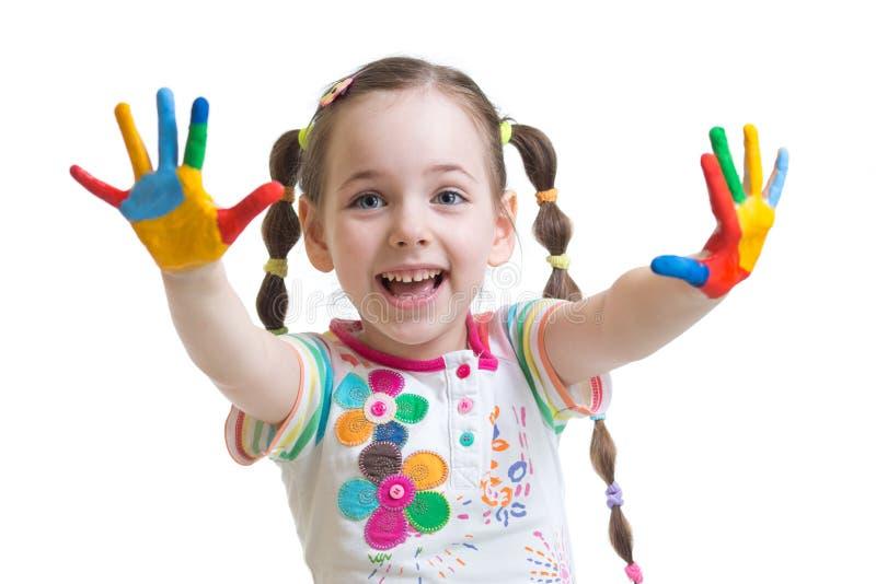 Śmieszna dziecko dziewczyna z malować rękami obrazy royalty free
