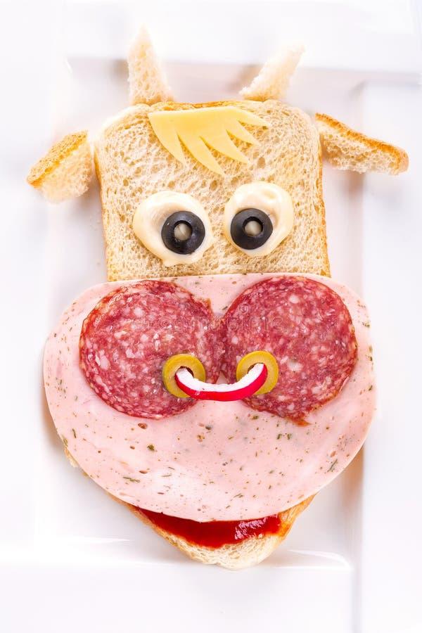 Śmieszna kanapka w krowa kształcie obraz royalty free