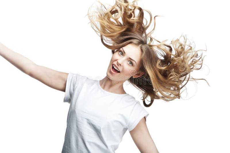Śmieszna młoda kobieta z latającym włosy zdjęcie royalty free