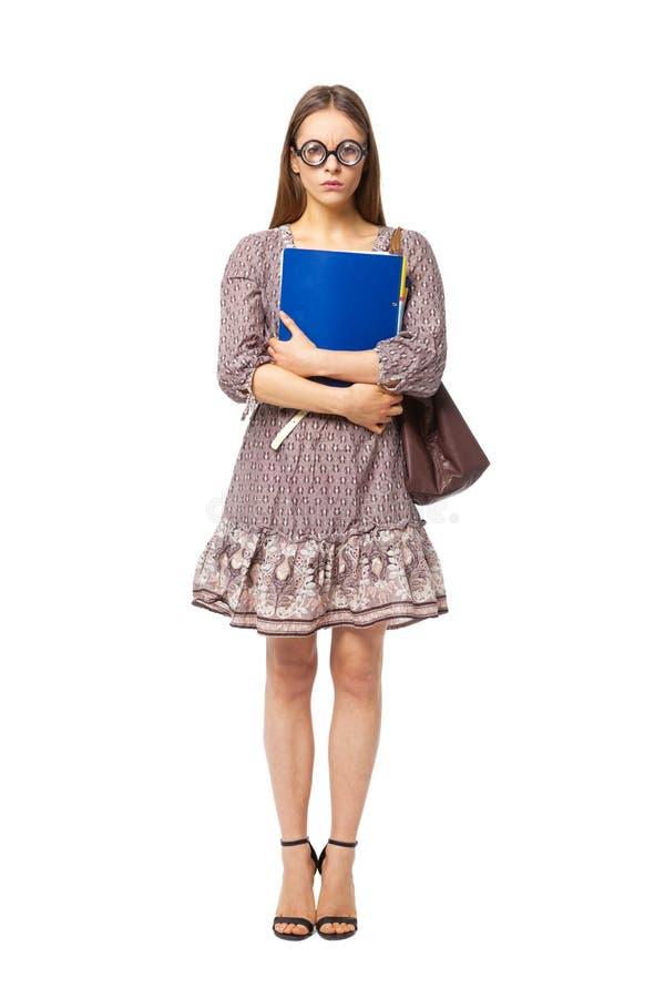 Śmiesznego głupka żeński uczeń z książkami odizolowywać na bielu obraz stock