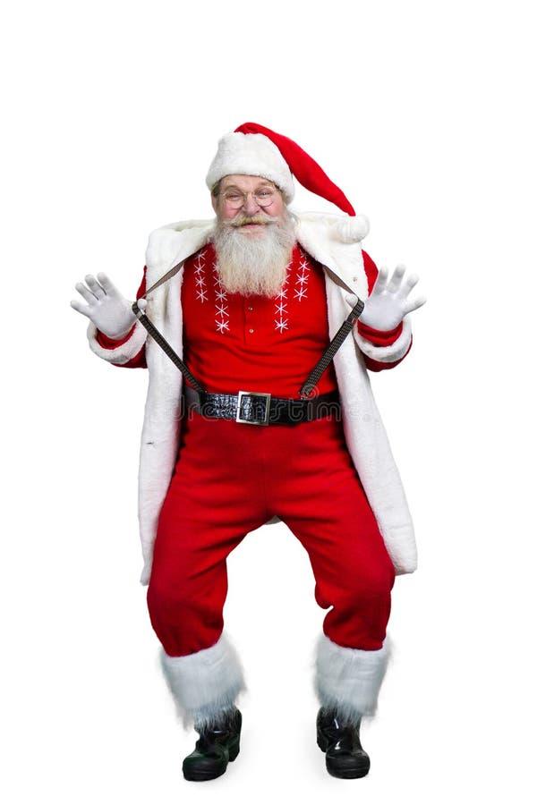 Śmieszny Święty Mikołaj trzyma jego suspenders obrazy stock