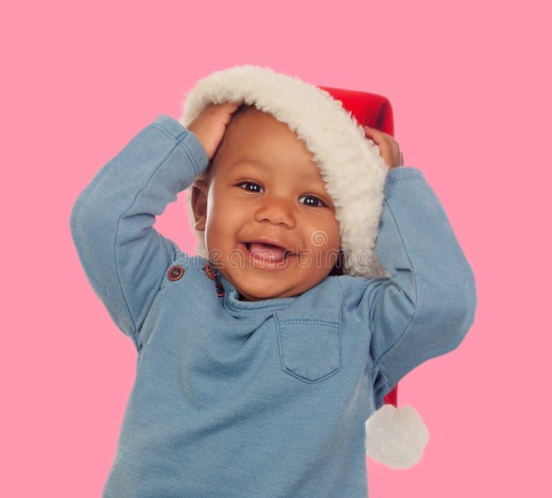 Śmieszny afrykański dziecko z boże narodzenie nakrętką fotografia royalty free