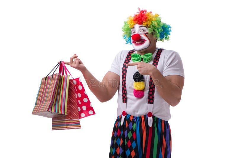 Śmieszny błazen po torba na zakupy odizolowywających na białym tle zdjęcie stock