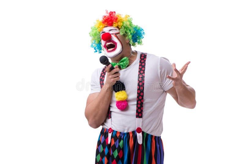 Śmieszny błazen z mikrofonu śpiewackim karaoke odizolowywającym na bielu fotografia stock