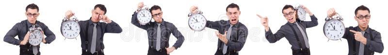 Śmieszny biznesmen z zegarem odizolowywającym na bielu zdjęcia stock