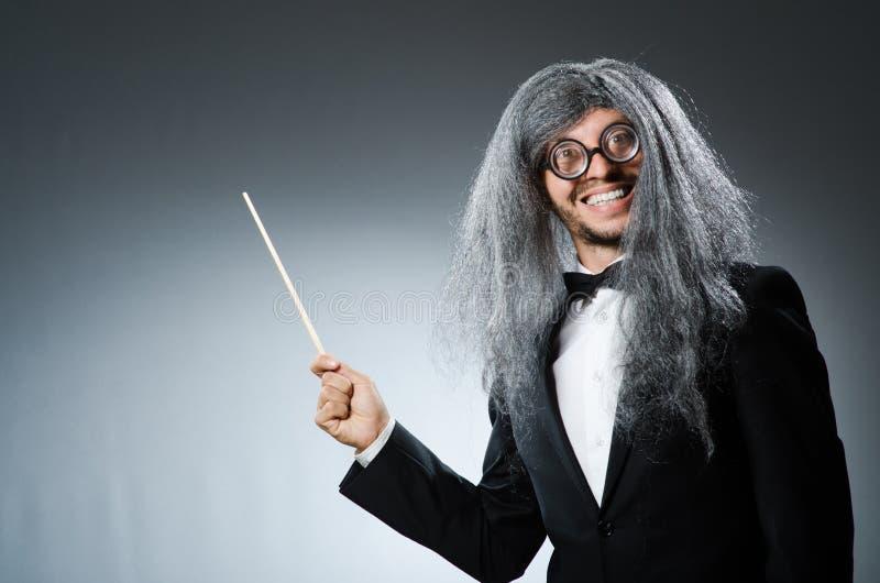 Śmieszny dyrygent z długim zdjęcie royalty free