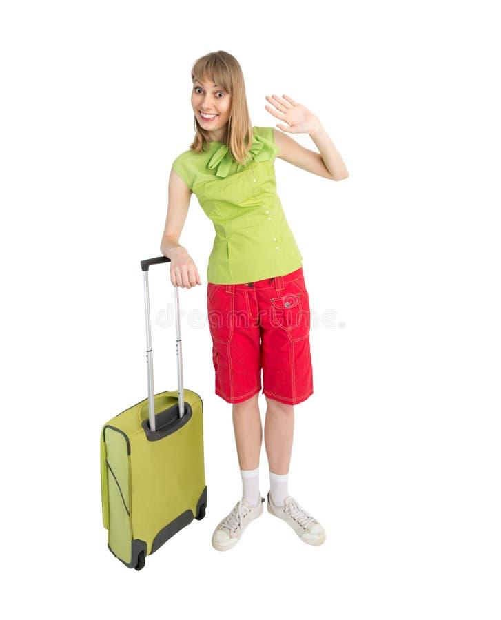 Śmieszny dziewczyna turysta z torbą w czerwonych skrótach obraz royalty free