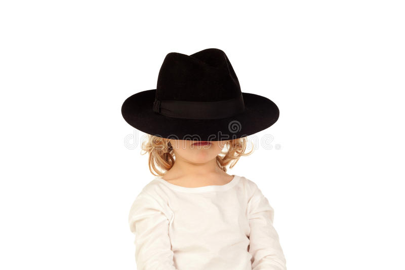 Śmieszny mały blond dziecko z czarnym kapeluszem fotografia stock