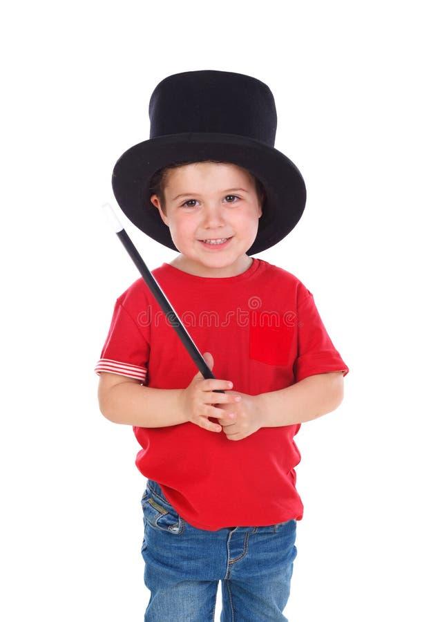 Śmieszny mały magik z odgórnym kapeluszem i magiczną różdżką obrazy stock