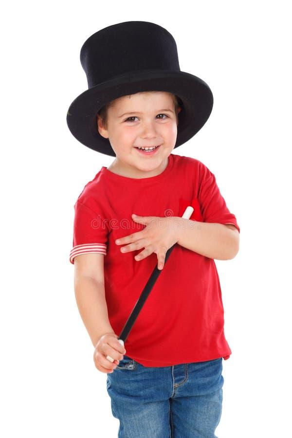 Śmieszny mały magik z odgórnym kapeluszem i magiczną różdżką zdjęcie royalty free