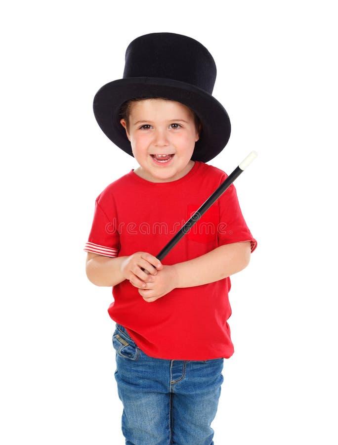 Śmieszny mały magik z odgórnym kapeluszem i magiczną różdżką zdjęcia stock
