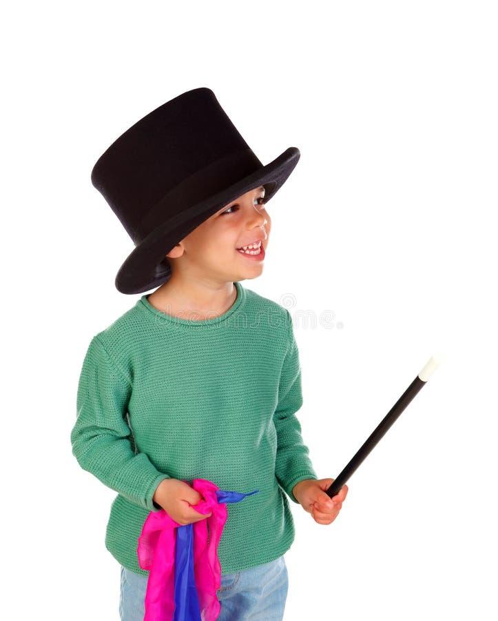 Śmieszny mały magik z odgórnym kapeluszem i magiczną różdżką fotografia royalty free
