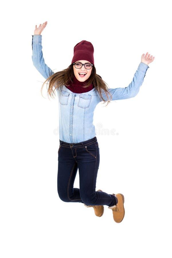 Śmieszny nastoletniej dziewczyny doskakiwanie odizolowywający na bielu zdjęcie royalty free