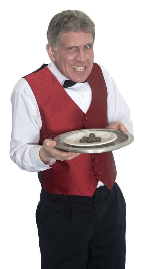 Śmieszny Podły kelner porci psa kaku, Odizolowywający fotografia stock