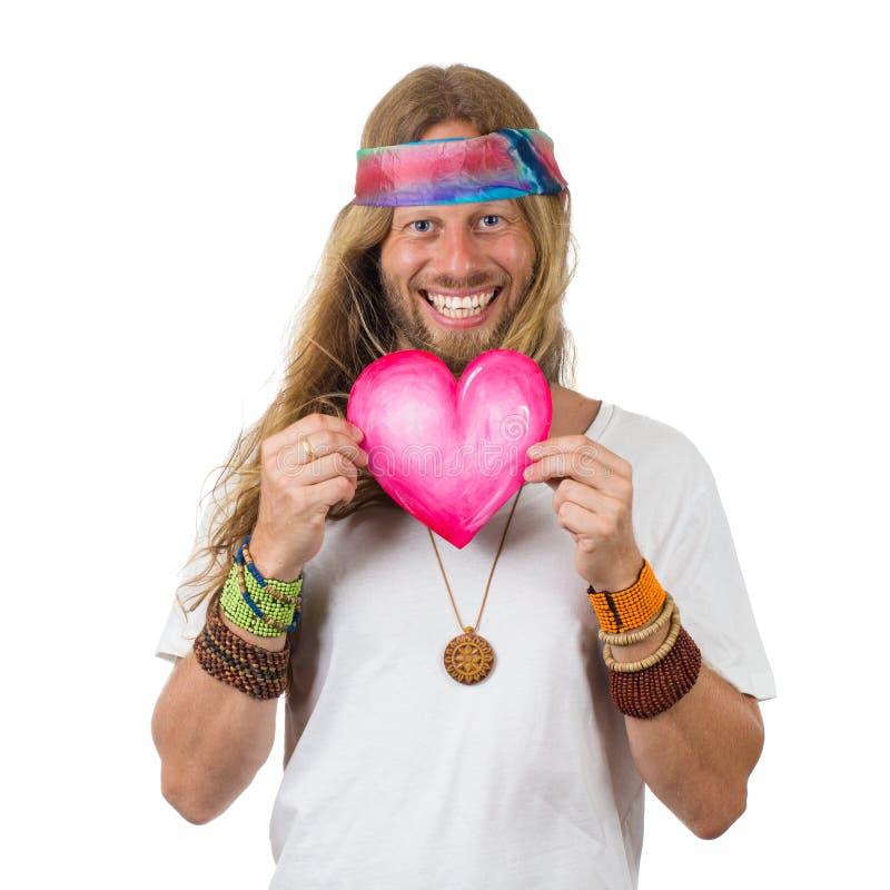 Śmieszny uśmiechnięty hipis trzyma miłości kierowa obrazy stock