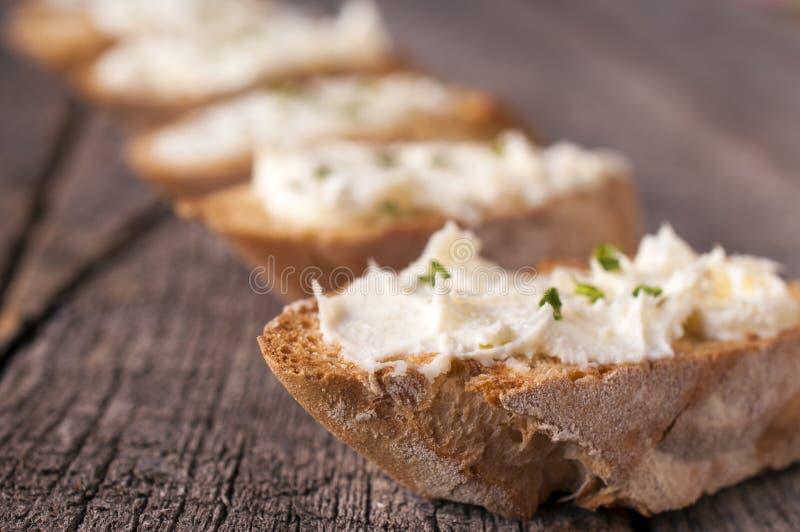 Śmietanka na chlebie fotografia stock