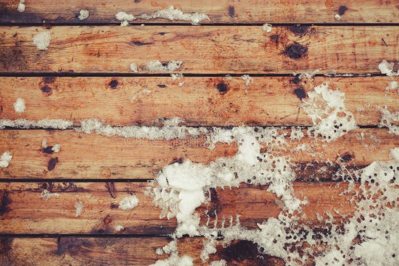 Śnieg na floorboard podczas zimy obraz stock