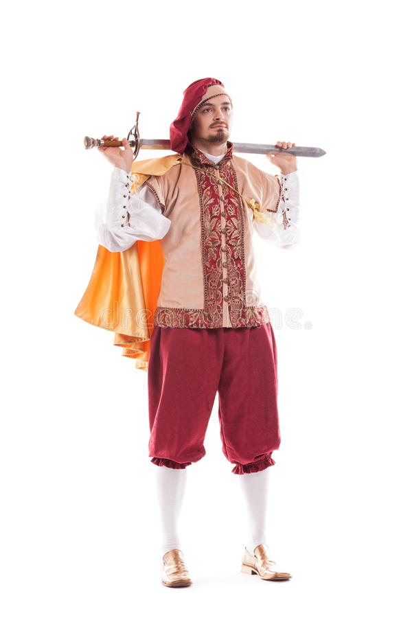 Średniowieczny mężczyzna rycerz z długie włosy i kordzikiem fotografia royalty free