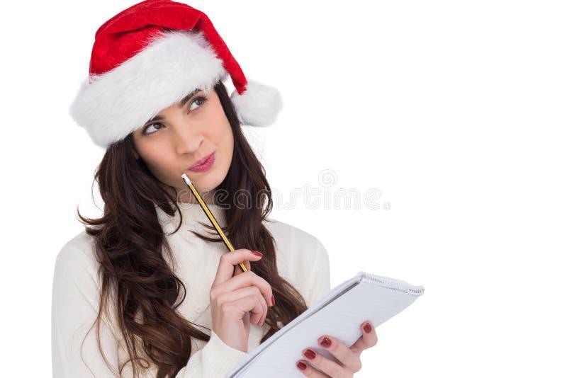 Świąteczna brunetka myśleć o jej boże narodzenie liście obrazy stock