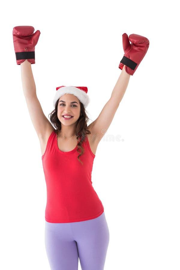 Świąteczna brunetka w bokserskich rękawiczek rozweselać zdjęcia stock