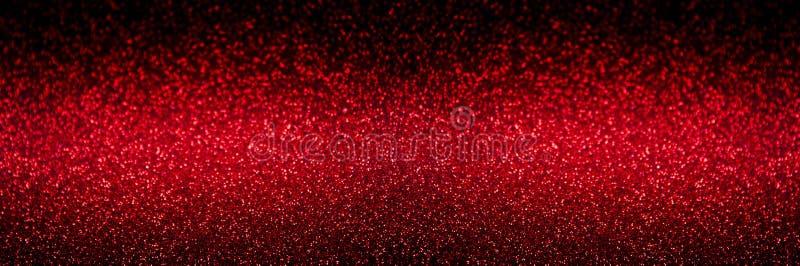 Świąteczny Czerwony abstrakt zamazujący błyskotliwości tło zdjęcia royalty free