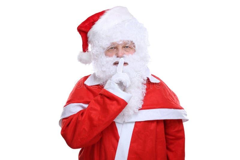Święty Mikołaj boże narodzenia ma sekret odizolowywającego na bielu zdjęcie royalty free