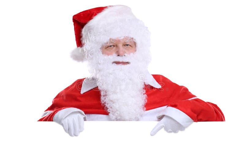 Święty Mikołaj boże narodzenia pokazuje pustego sztandar z copyspace zdjęcie stock
