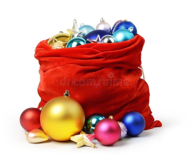 Święty Mikołaj czerwona torba z Bożenarodzeniowymi zabawkami zdjęcia royalty free