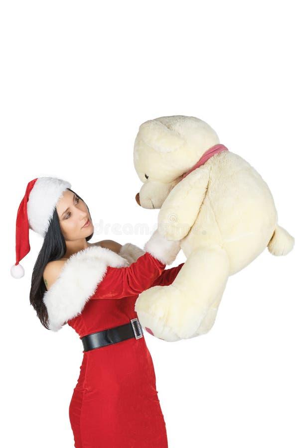 Święty Mikołaj dziewczyna trzyma misia Prezent dla dziewczyn fotografia royalty free