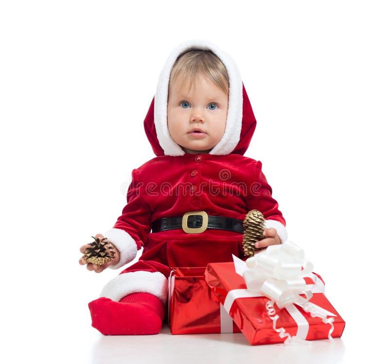Święty Mikołaj dziewczynka z prezenta pudełkiem odizolowywającym na białym tle zdjęcia royalty free