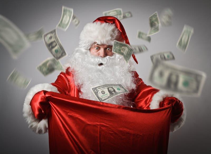 Święty Mikołaj i worek z dolarami obraz stock