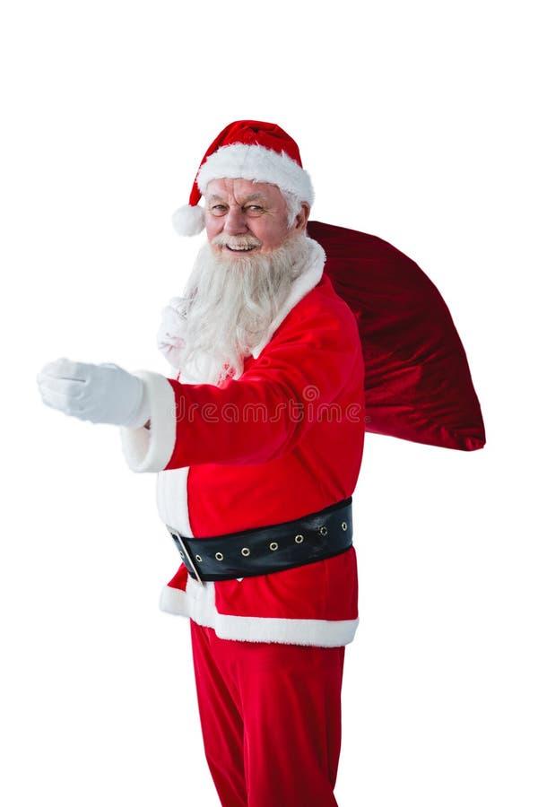 Święty Mikołaj mienia bożych narodzeń torba obraz stock