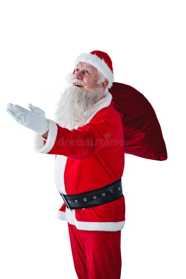 Święty Mikołaj mienia bożych narodzeń torba obraz royalty free