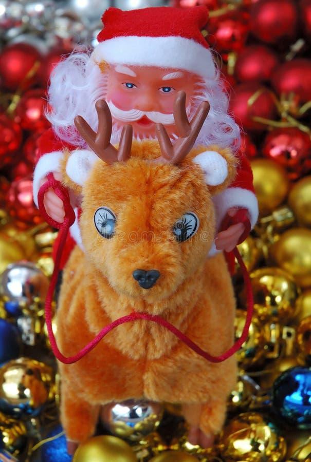 Święty Mikołaj na reniferze zdjęcie stock