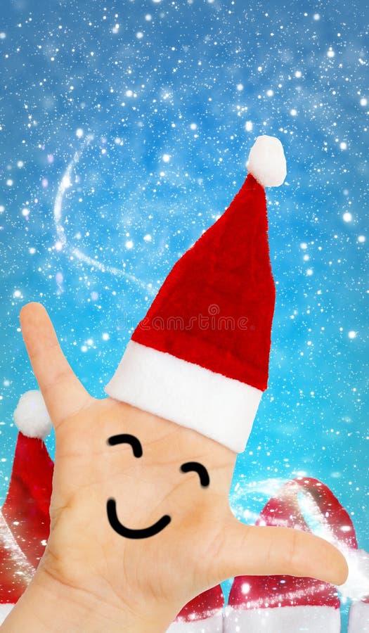 Święty Mikołaj, ręka z Santa kapeluszem i twarz przed śnieżnym flurr, obrazy royalty free