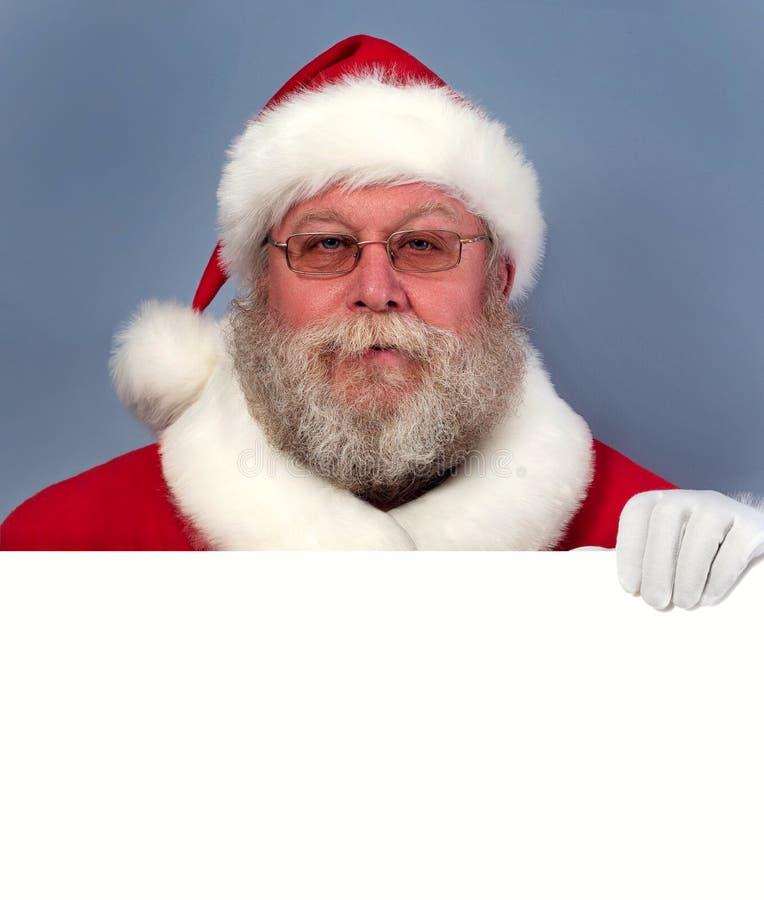 Święty Mikołaj trzyma białą deskę fotografia stock