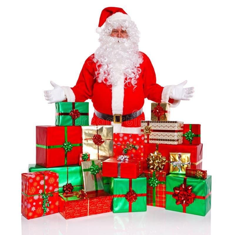 Święty Mikołaj z prezent zawijać teraźniejszość obrazy royalty free