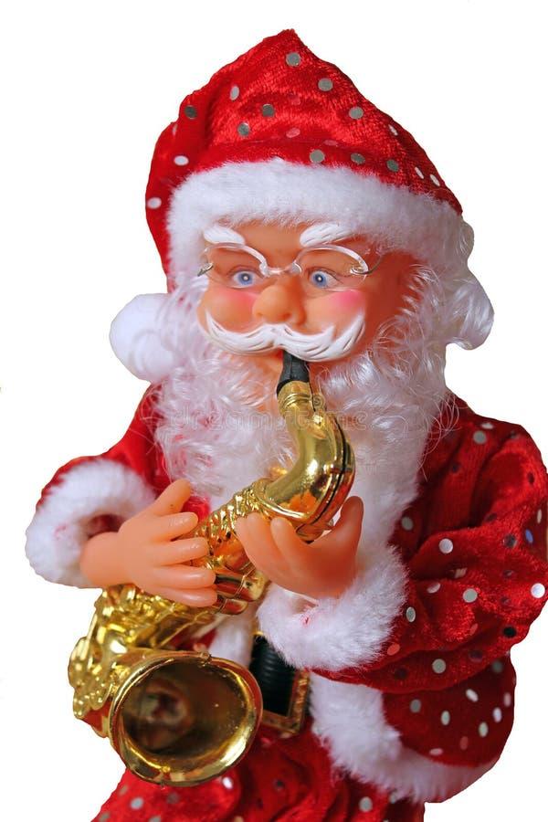 Święty Mikołaj z saksofonem zdjęcie royalty free