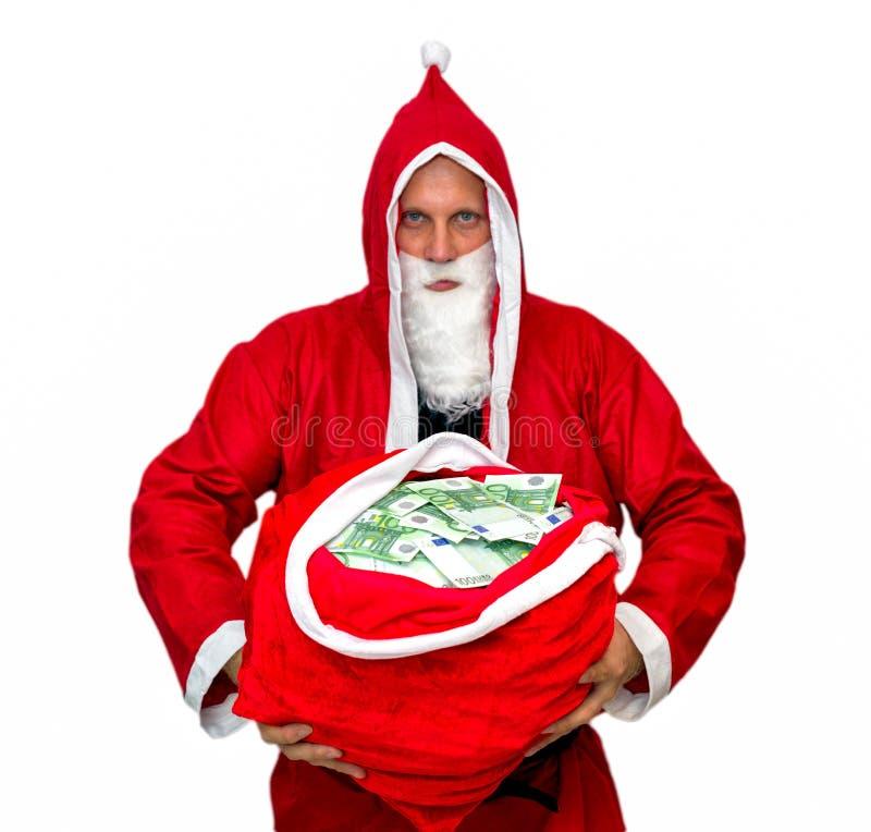 Święty Mikołaj z torbą pełno pieniądze obrazy stock