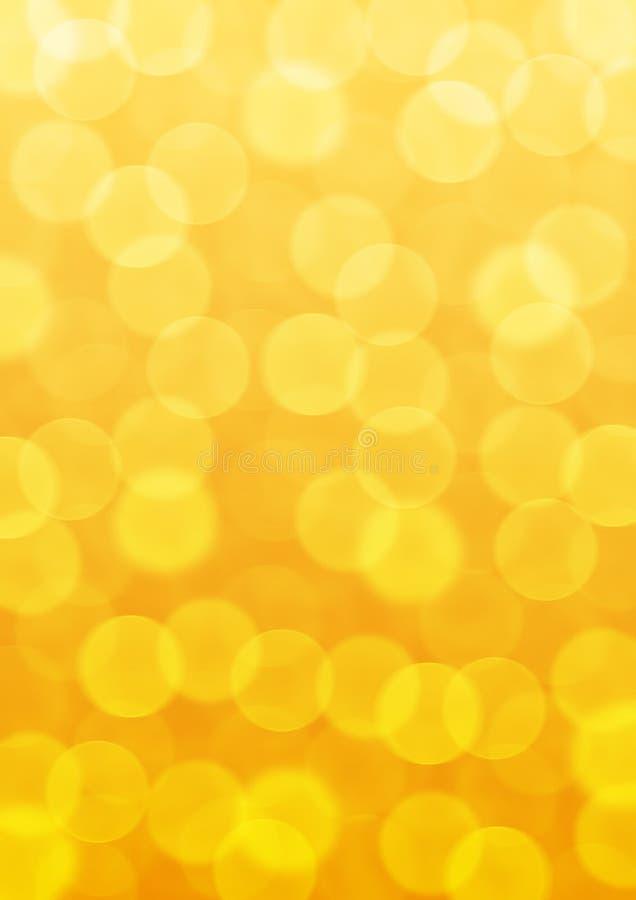 Światła Bokeh w żółtym tle zdjęcia royalty free