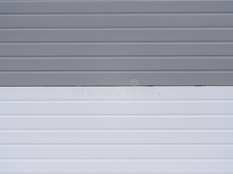 Światła - szary i biały winylowy popiera kogoś tło Kolorowe tekstury od outside Klingerytów panel ściana zdjęcia royalty free